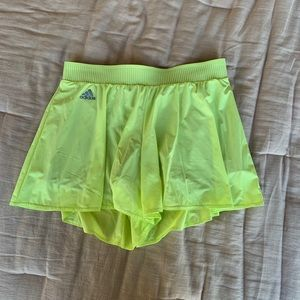 Bright yellow adidas skort